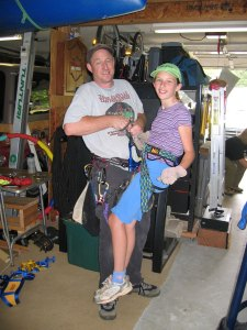 Emma, learning about repelling from Phill's partner, Carl, who, along with his wife Connie, replled into a lot of caves.