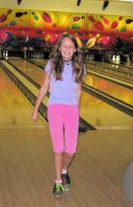 Another mother and I took the church youth group on a bowling trip.  I guess you can tell Emma wasn't a great bowler, but it was fun anyway!  Here she is hamming it up after her gutterball.