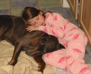 Emma pretending to sleep on the kitchen floor with our dog, Jinxy.  Emma Roey, Emma Kate Roey, Emma Katherine Roey