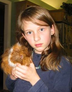 When Emma was about 3, we got our first guinea pig, whom Emma named Milkbone, from the Atlanta Humane Society.  She was a great little pig, and lived 5 1/2 years.  Emma Roey, Emma Katherine Roey, Emma Kate Roey