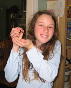 Emma in her pjs, holding a little snake I found In the yard.  Emma Kate Roey, Emma Roey, Emma Katherine Roey Emma Buchheim
